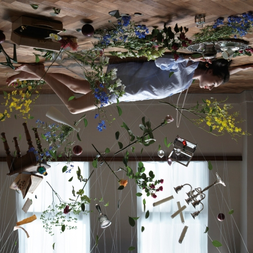"""Created by Japanese artist NAM, the cover for Sun Airway's """"Soft Fall"""" is an intricate web of dishes, flowers, and a candelabra. When asked about his inspiration, NAM said, """"Our aim was to perfectly match the world of Sun Airway's music and take that world of sound and enlarge its image visually."""" Mission accomplished."""