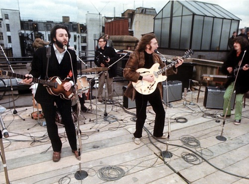 "During their last performance on the roof of Apple Studios, The Beatles performed ""Get Back."""