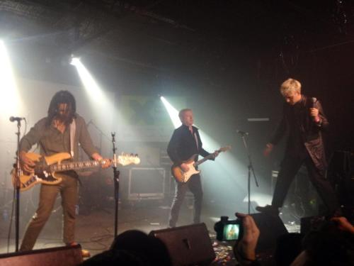 The singer looked like a villain from an 80s movie with his spiked, bleach blond hair and over-sized leather jacket